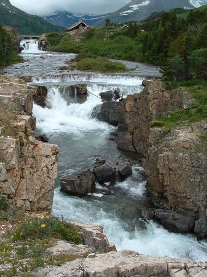 photo of Swiftcurrent Lake waterfall