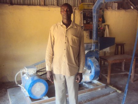 photo of Douglas Osusu and posho grinding mills