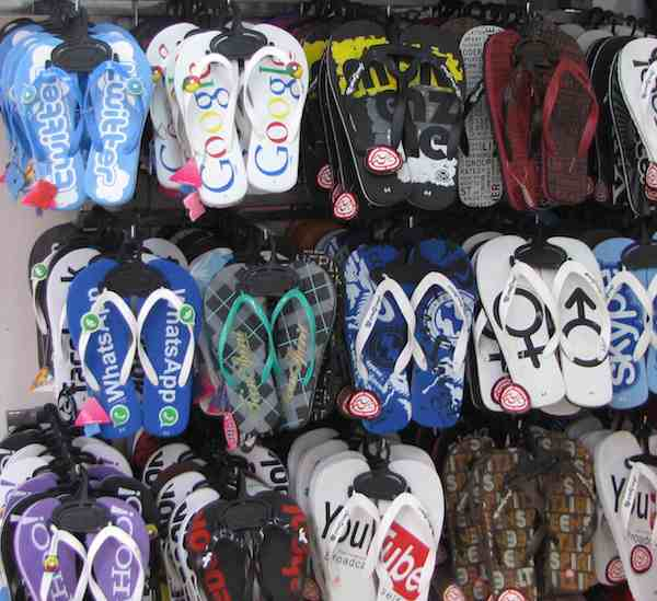 photo of flip flops for sale with global band images: Google, Twitter, Skype...