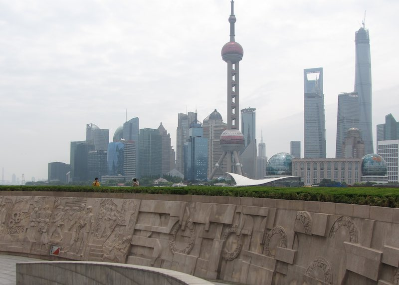 Monument to the People's Heroes with the Shanghai skyline in the background